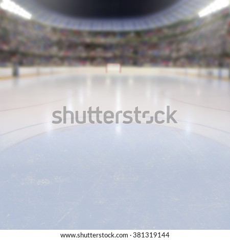 On ice low-angle view of a dramatic hockey arena full of fans in the stands with copy space. Deliberate focus on foreground ice and shallow depth of field on background with lighting flare effect.