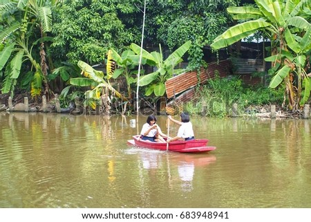 On July 25, A.D.2017, Thai students paddled in the natural canals of Bangkok's suburbs.