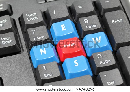 on line news word on black keyboard, red and blue button