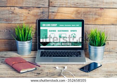On line shop website template design on a laptop. Office desk.