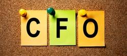 On multicolored stickers in black letters the inscription CFO.