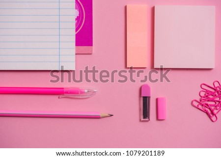 On pink background, school accessories and a pen, colored pencils, a pair of compasses, a pair of compasses, a pair of scissors. Copy space, top view #1079201189