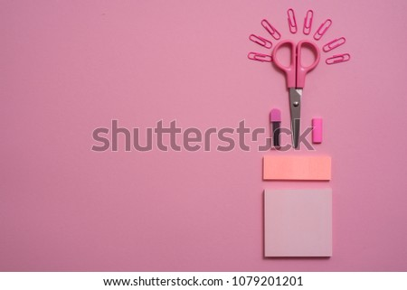 On pink background, school accessories and a pen, colored pencils, a pair of compasses, a pair of compasses, a pair of scissors. Copy space, top view #1079201201