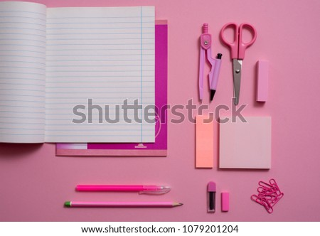 On pink background, school accessories and a pen, colored pencils, a pair of compasses, a pair of compasses, a pair of scissors. Copy space, top view #1079201204