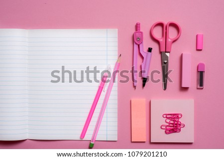 On pink background, school accessories and a pen, colored pencils, a pair of compasses, a pair of compasses, a pair of scissors. Copy space, top view #1079201210