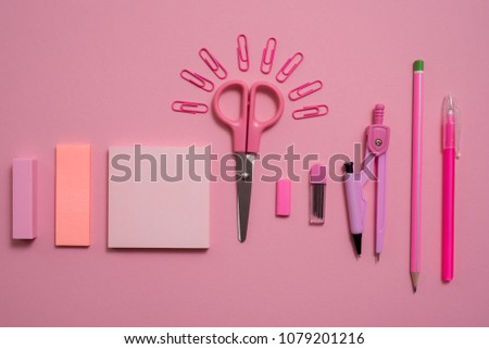 On pink background, school accessories and a pen, colored pencils, a pair of compasses, a pair of compasses, a pair of scissors. Copy space, top view #1079201216