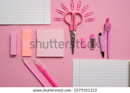 On pink background, school accessories and a pen, colored pencils, a pair of compasses, a pair of compasses, a pair of scissors. Copy space, top view #1079201222