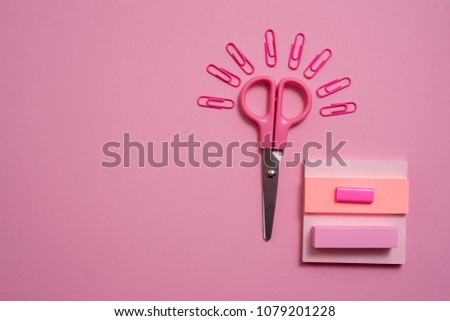 On pink background, school accessories and a pen, colored pencils, a pair of compasses, a pair of compasses, a pair of scissors. Copy space, top view #1079201228