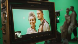 On Set Display Showing: Green Screen Scene with Two Actors Talented Wearing Renaissance Costumes Doing Romantic Drama Dialogue. Film Studio Professional Crew Shooting Historical Costume Drama Movie