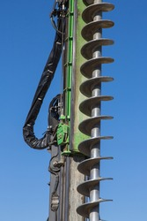 On site: detail of a huge earth drill with screw to excavate the building pit, closeup