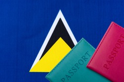 On the background of the flag of St. Lucia two passports. The concept of travel and tourism.