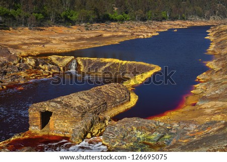 On the bed of the Tinto river there are many old watermills - stock photo