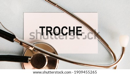 On the business card the text troche, next to the stethoscope. Zdjęcia stock ©