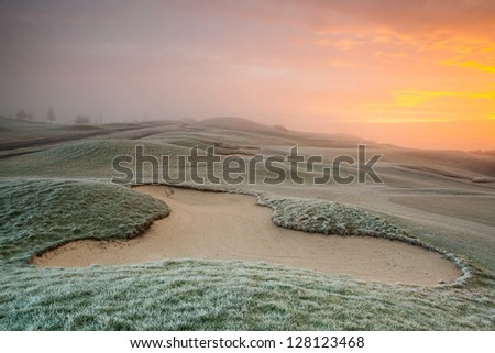 On the empty golf course in winter morning