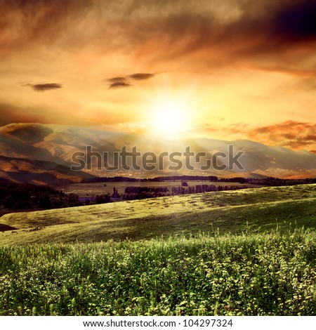 on the evening. rural summer landscape close to high mountain