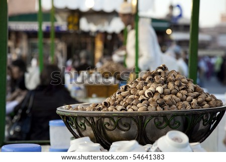 On the famous Place el Fna in Marrakesh, Morocco, a overly filled wok with snails is waiting to be consumed