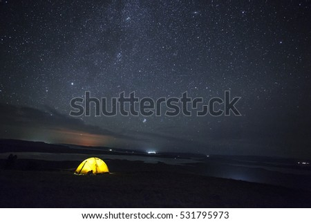 On the hill above the starry sky in the lake #531795973