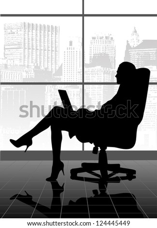 on the image the woman at office at the computer is presented