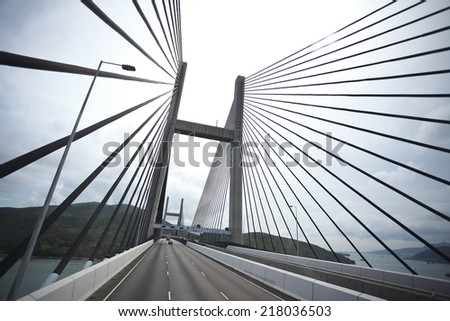 On the left side of the highway driving route at Bottom looking up of modern cable-stayed bridge