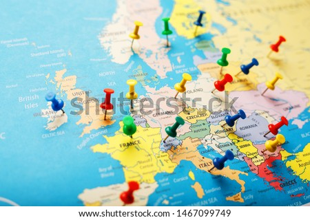 On the map of Europe, the colored buttons indicate the location and coordinates of the destination. Country Policy Concept