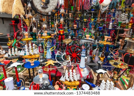 On the market in the old city of Acre in northern Israel are sold hookah, souvenirs and carpets of different bright colors and designs. #1374483488