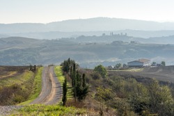 On the path of the Eroica Competition, off-road in tuscany in the chianti hills near siena, italy. The theme of the event is vintage cycling, with participants using vintage (pre-1987) bikes.