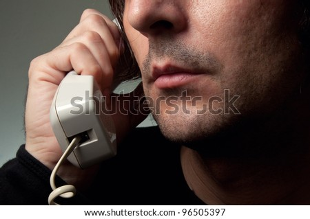 On the phone. Caucasian man on the phone.