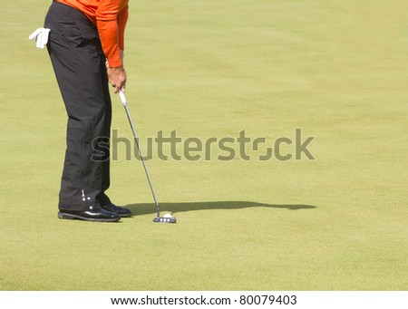 On the putting green taking the ball to the cup