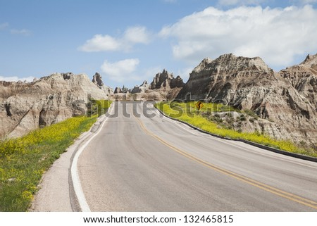 On the road in Badlands National Park, South Dakota, USA