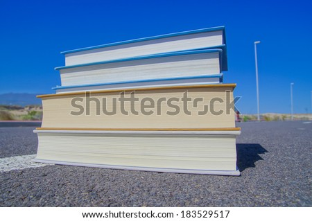 On the Road Literature Concept Books over Asphalt