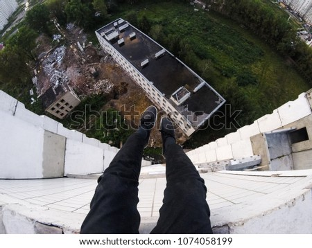 on the roof of the dangling legs. extreme