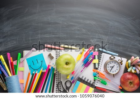 On the school board, school supplies. With an empty place for inscription or advertising. #1059076040