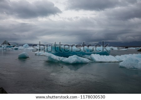 Stock Photo on the sea you can see melting ice bergs floating over the ocean in iceland