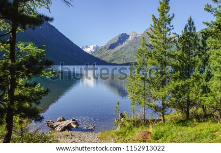 On the shore of a beautiful mountain lake, Multinsky Lakes in the Altai #1152913022