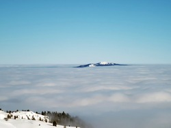 On the slopes of the Dôle, Switzerland, Saint-Cergue, canton of Vaud, stratus clouds with a view of the French Alps and the Barillette.