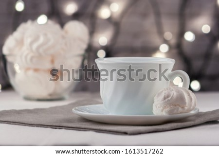 On the table is a cup of fresh aromatic coffee