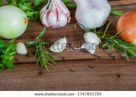 On the table - rosemary, young garlic (Latin ?llium sativum) and onions (Latin ?llium c?pa). They have an antiseptic effect and contain a complex of vitamins. Macro photo. Stock fotó ©
