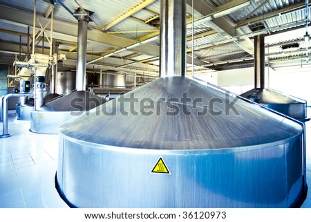 On the territory of brewer's plant, view to blue steel fermentation vats