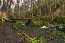 On the way through a small waterfall, Beaver Gorge, Czech Republic, spring time