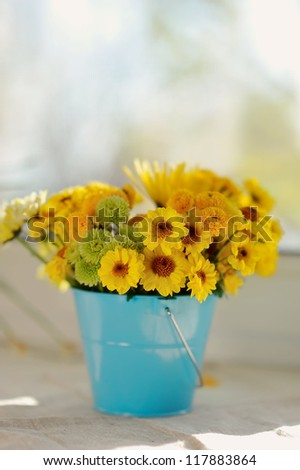 on the window sill in the sun bouquet of yellow flowers