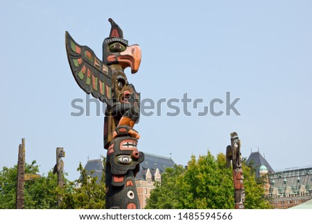 On Vancouver Island, British Columbia, a group of Totem poles made by indigenous people is found near the inner harbor in Victoria.  #1485594566