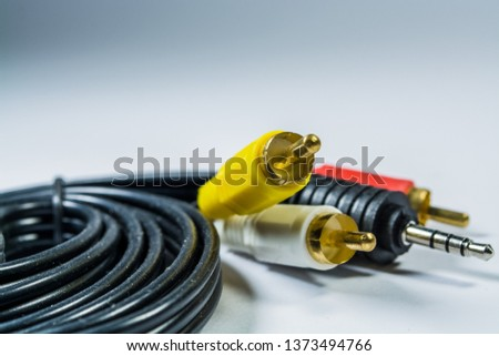 On white background hank of black cables with multi-colored plugs  tulip. Technologies. A multimedia wire for TV