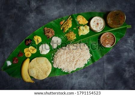 Onam feast / Kerala Ona-sadya served in banana leaf Zdjęcia stock ©