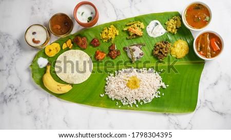 Onam Feast / Kerala Ona - Sadya served in banana leaf - South Indian vegetarian meal Zdjęcia stock ©