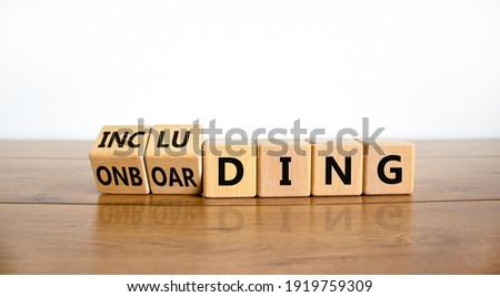 Onboarding and including symbol. Turned wooden cubes and changed the word 'onboarding' to 'including'. Beautiful white background, copy space. Business, onboarding and including concept. ストックフォト ©