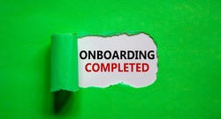 Onboarding completed symbol. Words 'Onboarding completed' appearing behind torn green paper. Beautiful green background. Business, onboarding completed concept, copy space.