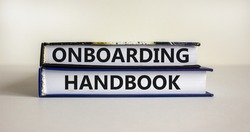 Onboarding handbook symbol. Books with words 'onboarding handbook' on beautiful white background. Business and onboarding handbook concept. Copy space.