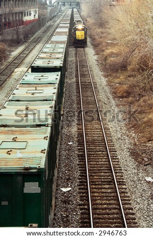 Oncoming cargo train pulling containers.