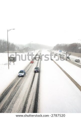 Oncoming traffic in a snowstorm
