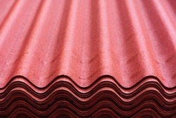 Onduline sheets. Roof covering made of modern materials. The building materials store has corrugated roof tiles made of bitumen and fiberglass. A large number of goods in stock. Close-up